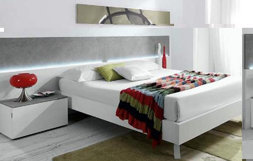 dormitorio de matrimonio blanco y gris